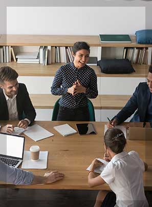 employees laugh discussing ideas at meeting